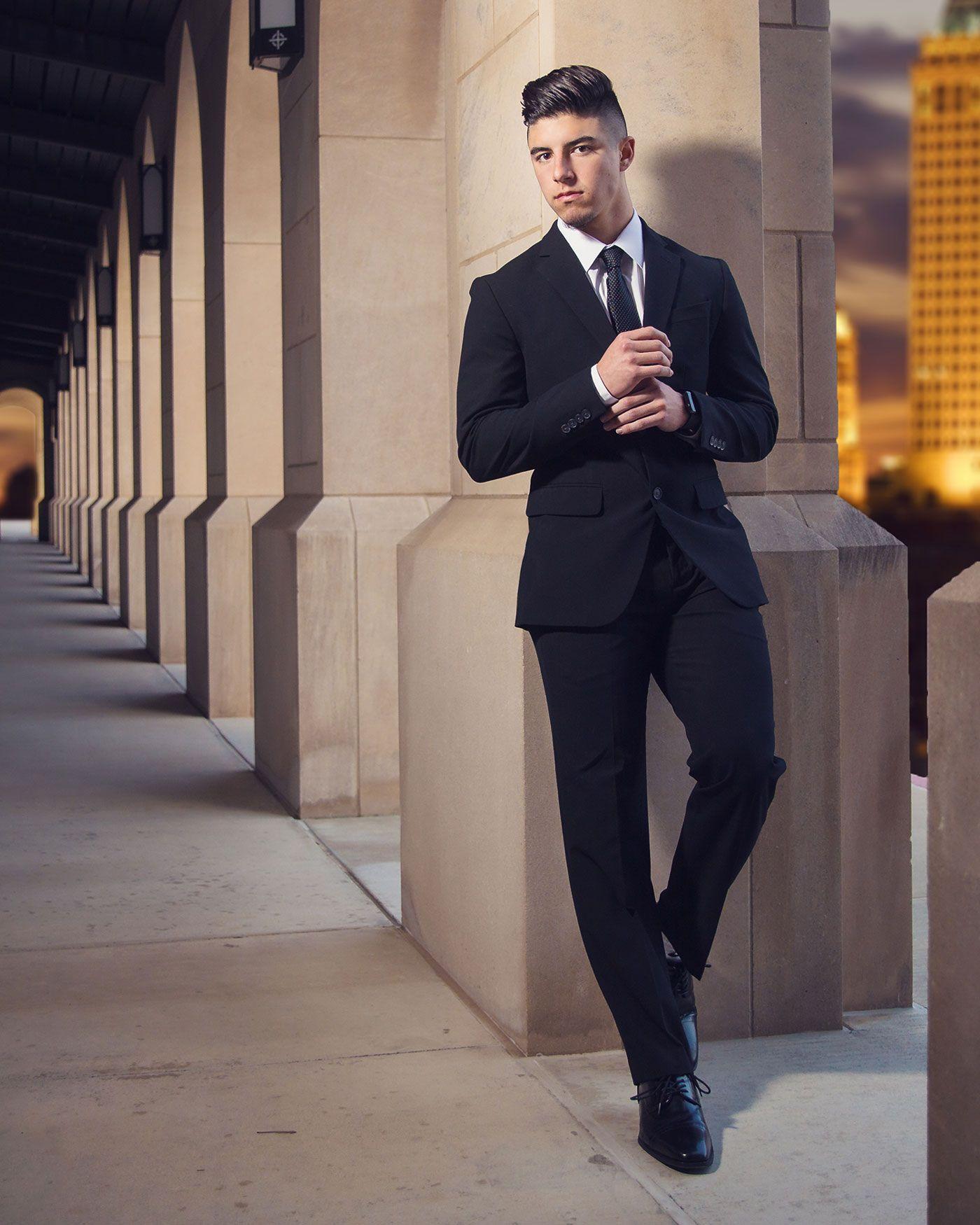 senior portrait of a boy in a suit