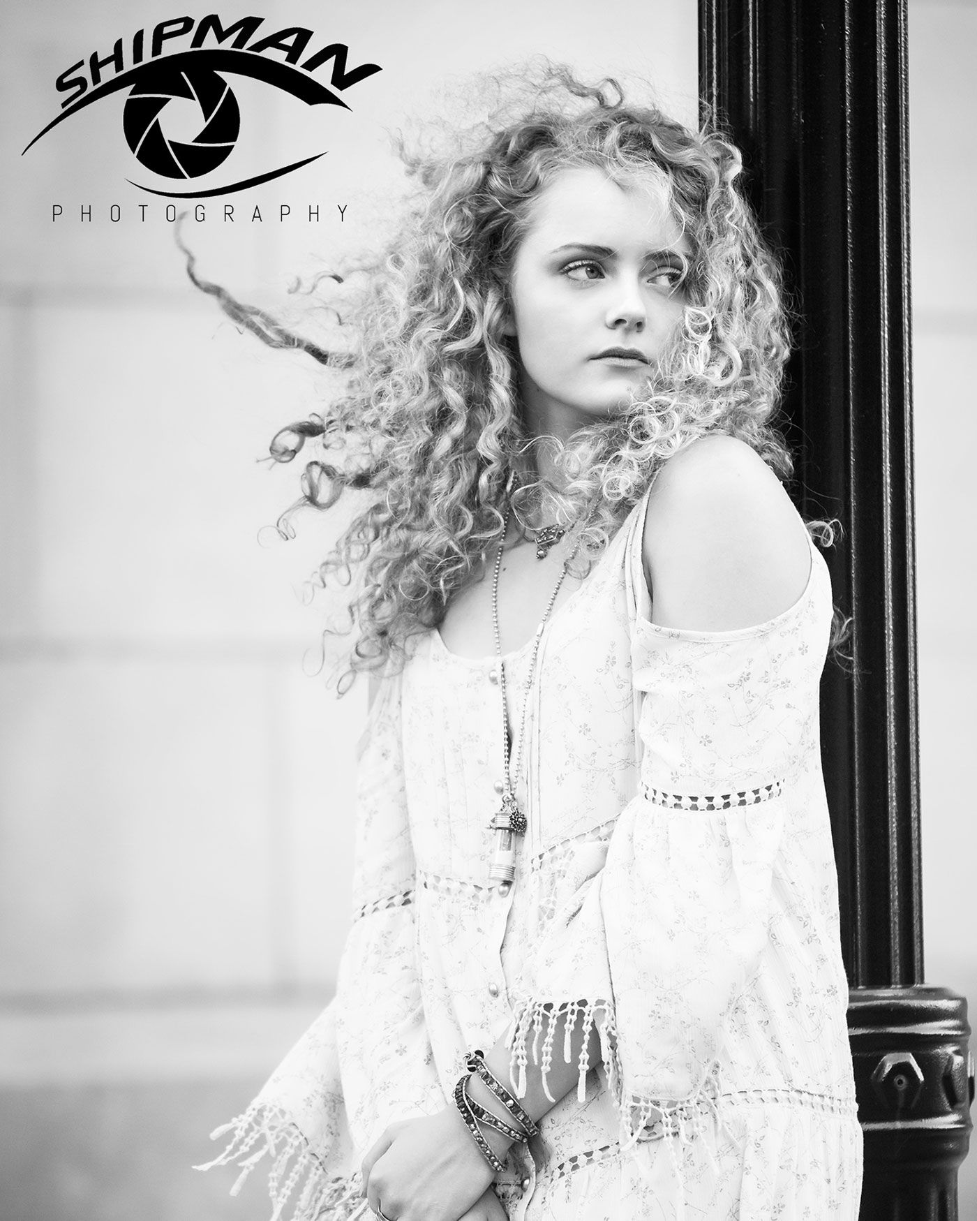 black and white senior girl with curly hair