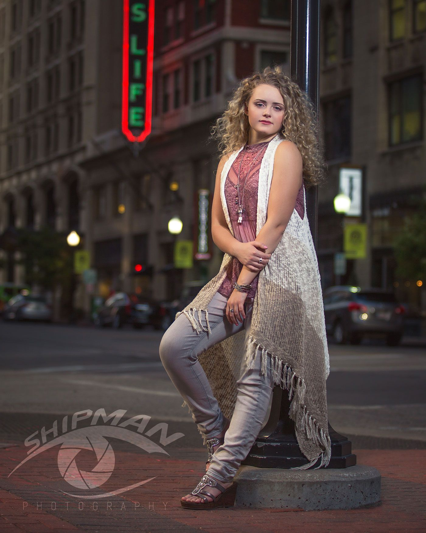 Senior portrait of a girl in the blue dome district in Tulsa