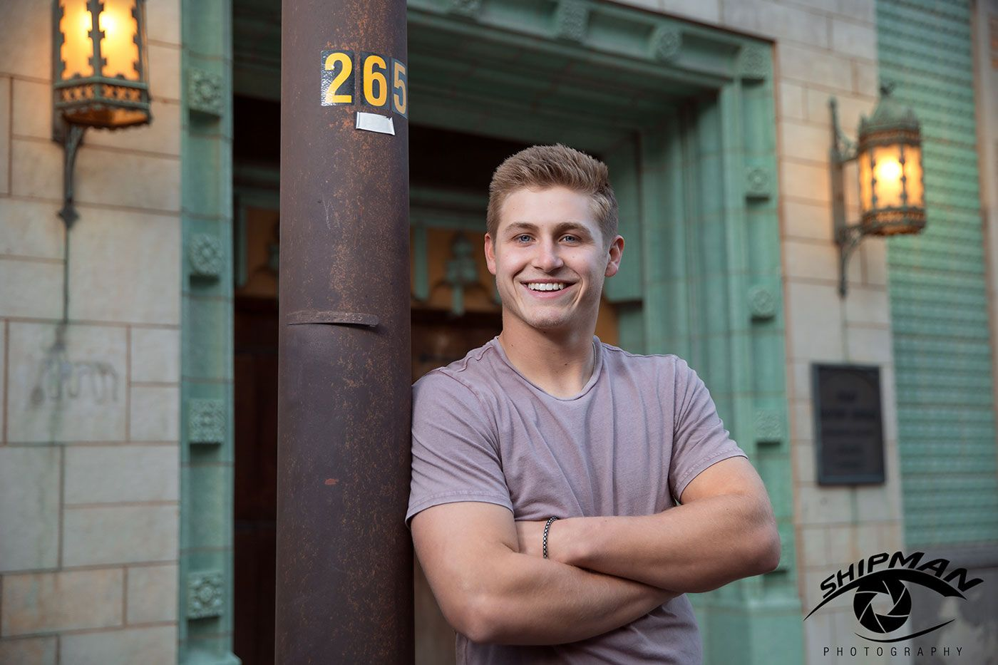 senior portrait of a boy in downtown Tulsa