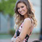 smiling high school senior girl in a natural light portrait