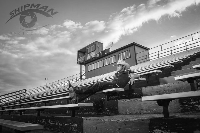 senior portrait boy football stadium cowboy hat
