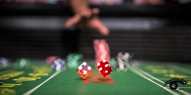 commercial photo of dice at a gaming table