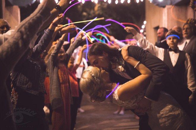Wedding candid of groom kissing bride