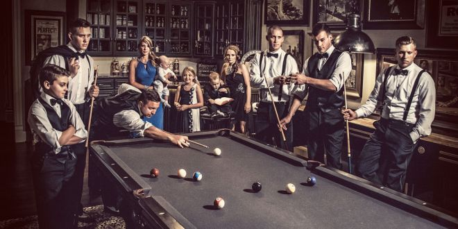 wedding party around the pool table